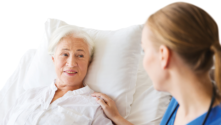 Image of patient in bed with a nurse